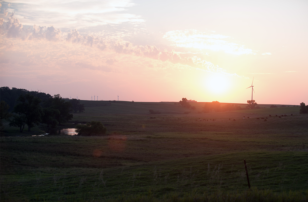 A View Of A Farm Field At Sunset