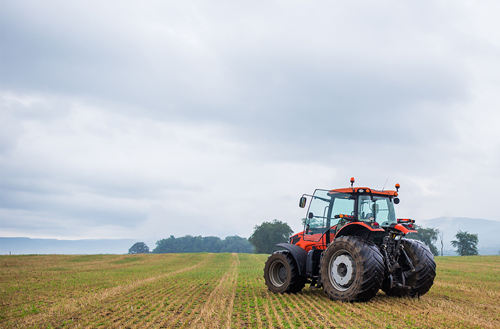 A View Of A Field With A Tractor