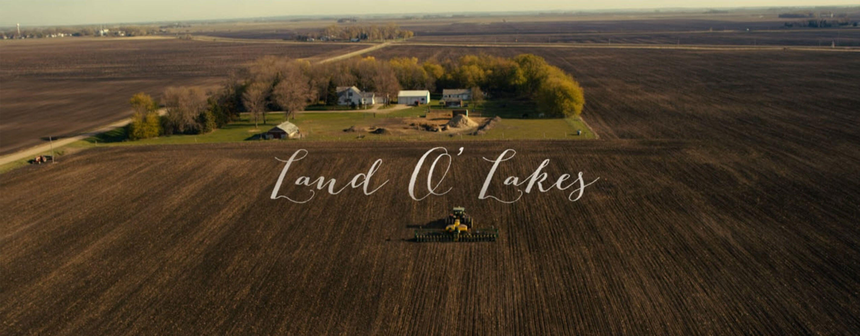 An Aerial View Of A Large Farm With The Text Land O