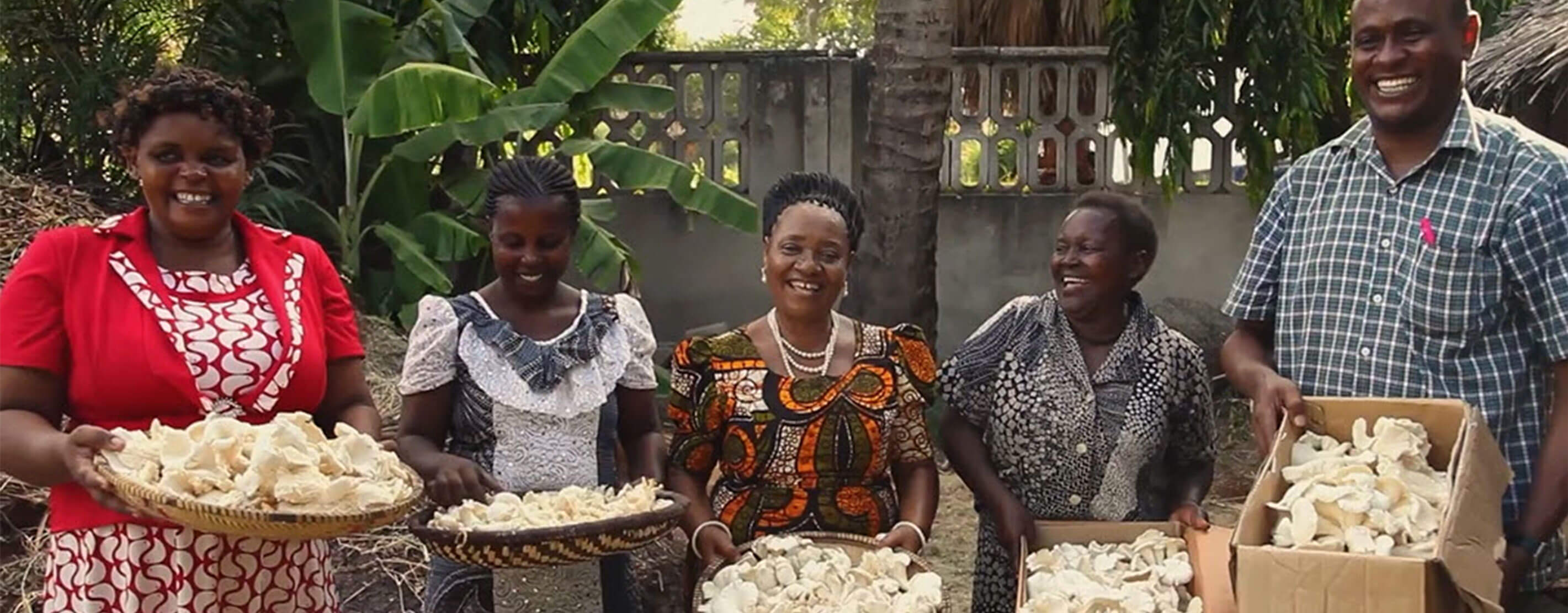 Women In Tanzania With Baskets Of Mushrooms