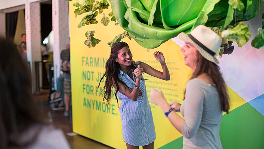 A Woman Approaching The Giant Head Of Lettuce At South By Southwest's The Food Effect