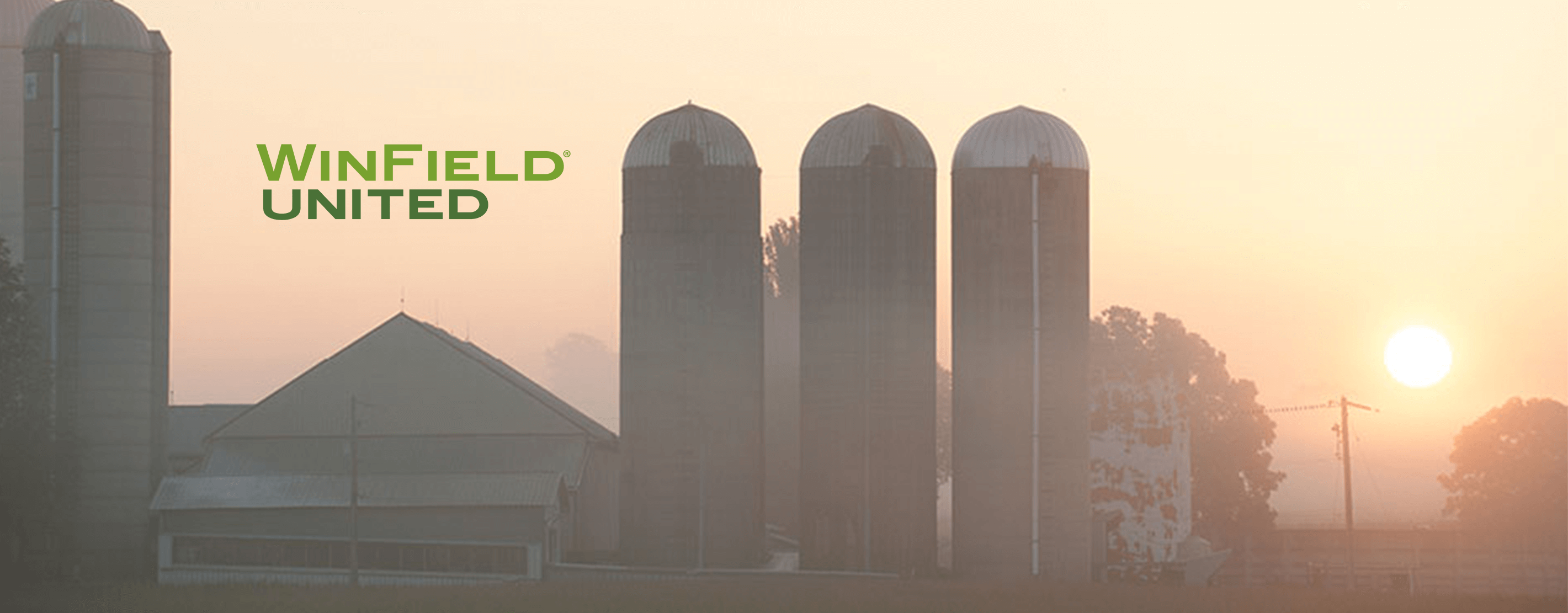 WinField United Logo Over A Farm At Sunrise