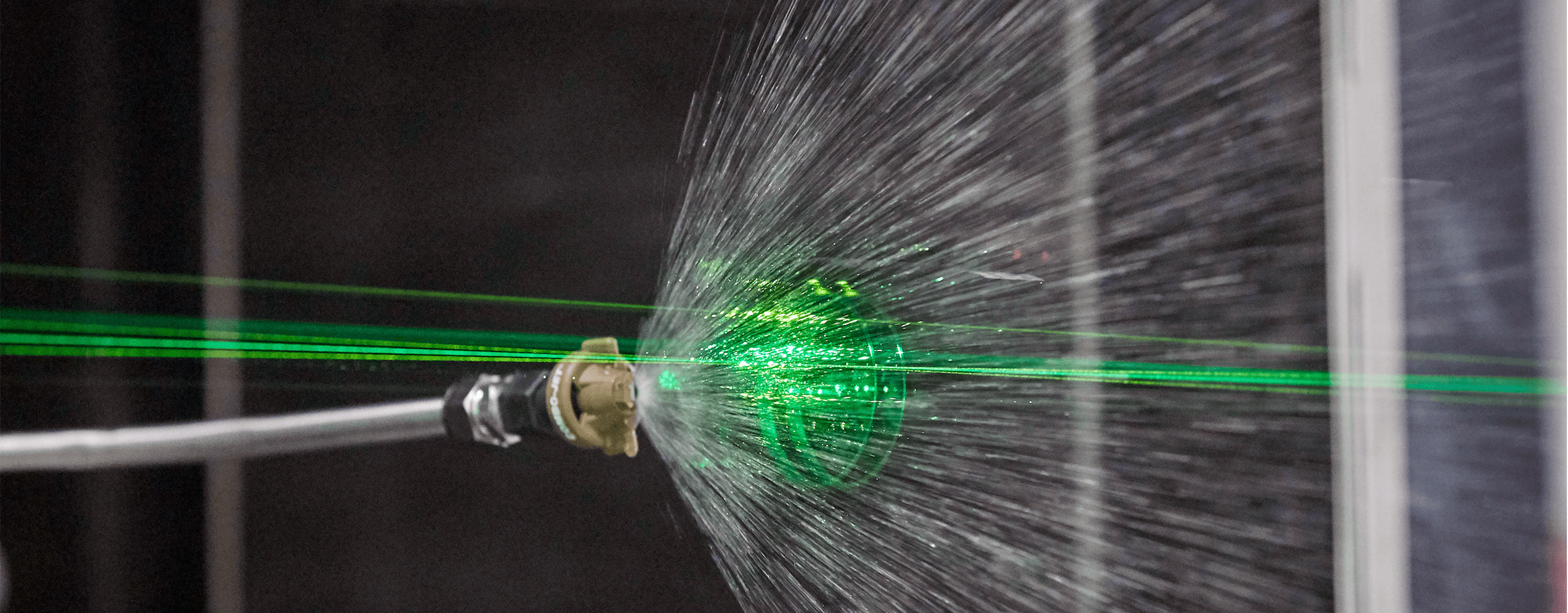 A Green Laser Analyzing Spray In A WinField United Research Lab