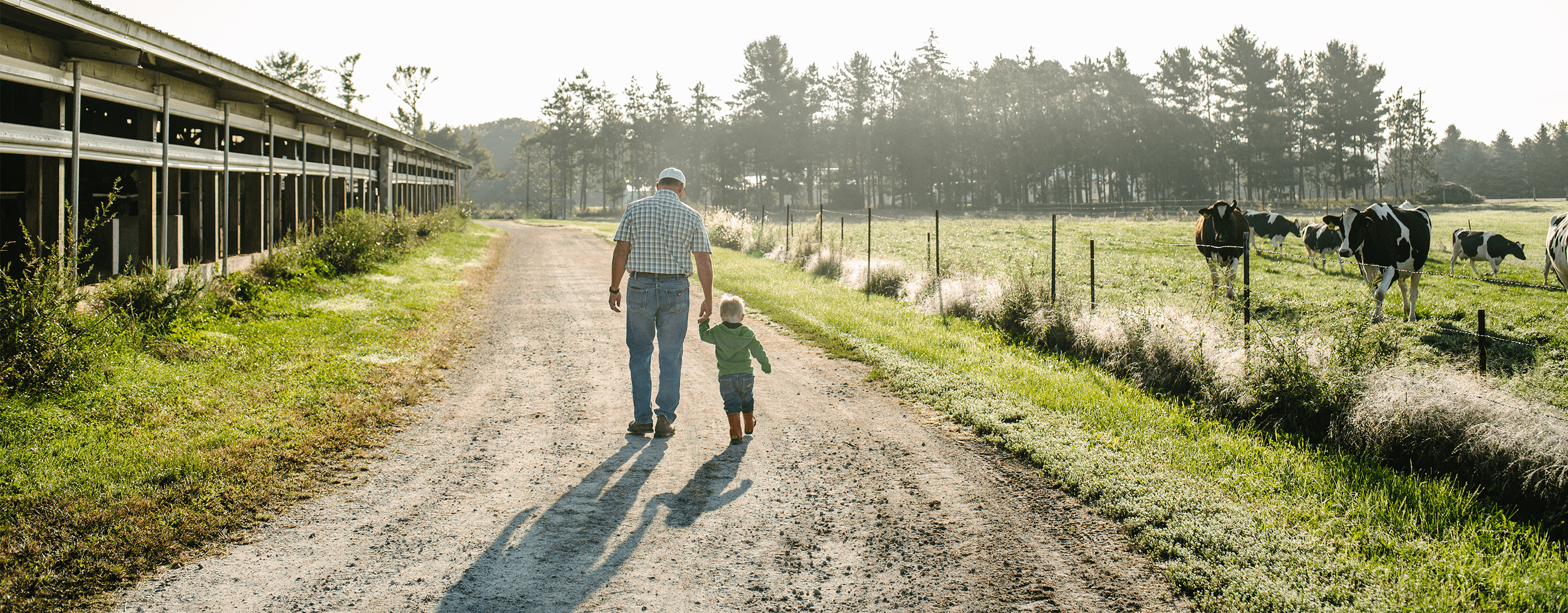 Pete Kappelman Walking On His Farm With His Grandson
