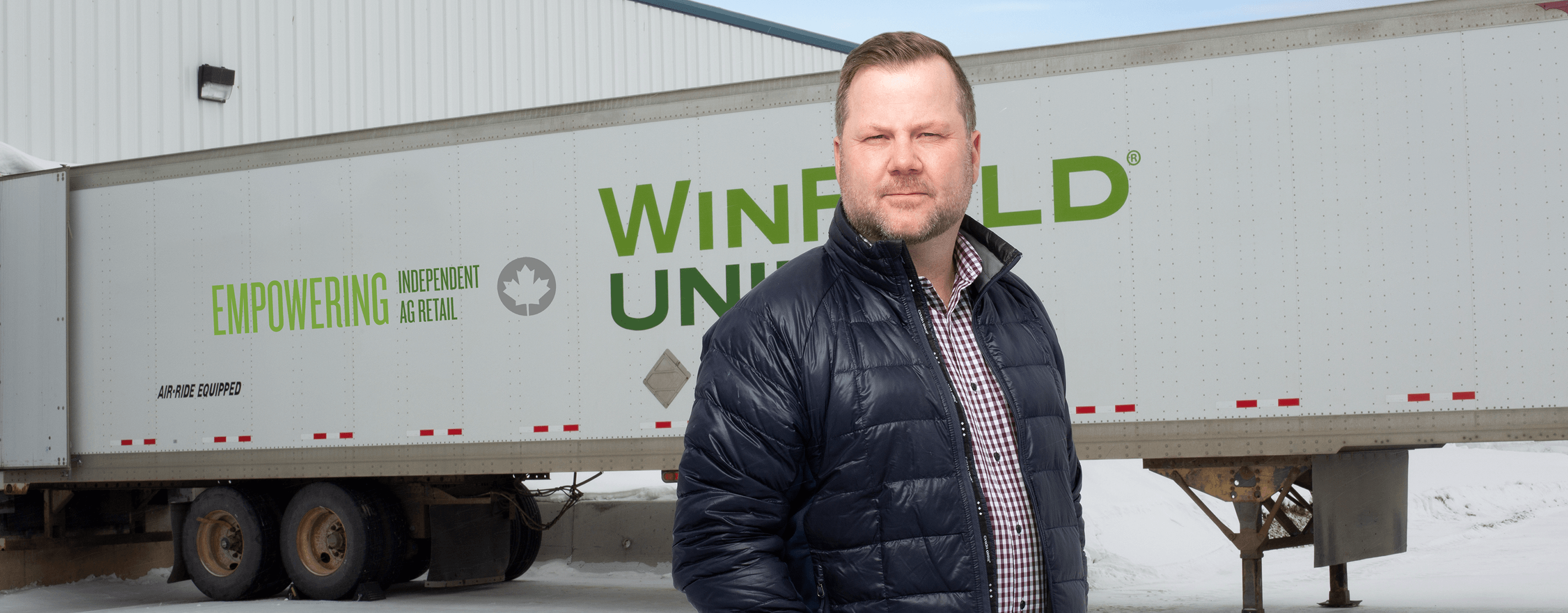 Greg McDonald Standing Next To A WinField United Truck