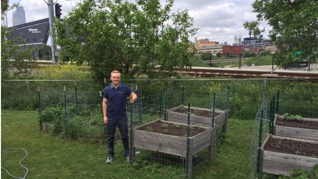 John Holm Next To A Community Garden