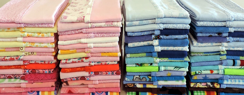 Stacks Of Colorful Baby Blankets